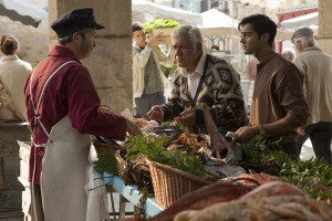 "HFJ-0103:.(Center) Papa (Om Puri) and Hassan (Manish Dayal) in DreamWorks Pictures' charming new film ""The Hundred-Foot Journey."".Photo: François Duhamel.©DreamWorks II Distribution Co., LLC. All Rights Reserved."